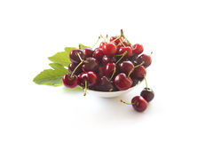 Cherries in a bowl on white Stock Photos