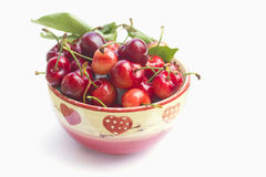 Cherries in a bowl on white Royalty Free Stock Images