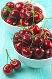 Cherries in bowls Stock Images