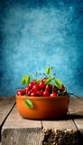 Cherries in brown plate Royalty Free Stock Photo