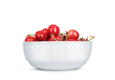 Cherries in a ceramic white plate on a white background Royalty Free Stock Images