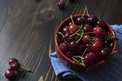 Cherries. Cherry. Cherries in color bowl and kitchen napkin. Stock Photography