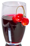 Cherries and cherry juice in a glass Stock Photos