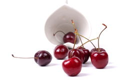 Cherries Chile and Heart-shaped mug on white. Royalty Free Stock Images