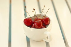 Cherries Chile in Heart-shaped mug on wood . Stock Images
