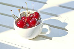 Cherries Chile in Heart-shaped mug on wood . Stock Photography