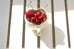 Cherries Chile in Heart-shaped mug on wood . Royalty Free Stock Photo