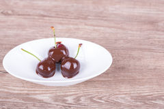 Cherries in chocolate royalty free stock photo