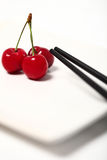 Cherries and chopsticks Royalty Free Stock Image