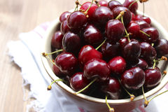 Cherries in a clay bowl. Berries cherries in a clay bowl on linen napkin Royalty Free Stock Photography