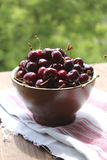 Cherries in a clay bowl. Berries cherries in a clay bowl on linen napkin Royalty Free Stock Photos