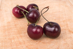 Cherries close-up on a wooden board Stock Photo