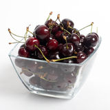 The cherries closeup isolated. The cherries closeup in glass cup isolated on the white Royalty Free Stock Photo