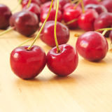 Cherries. Closeup of some appetizing cherries on a wooden surface Royalty Free Stock Photo