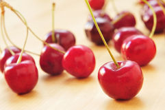 Cherries. Closeup of some appetizing cherries on a wooden surface Stock Images