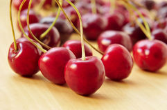 Cherries. Closeup of some appetizing cherries on a wooden surface Royalty Free Stock Photography