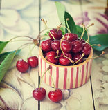 Cherries. Composition of cherries on a wood table stock photos