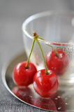 Cherries and cup Royalty Free Stock Photography