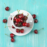 Cherries in cup Royalty Free Stock Photography