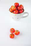 Cherries in cup on white. Royalty Free Stock Photography