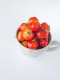 Cherries in cup on white. Red Cherries in cup on white background Royalty Free Stock Photos