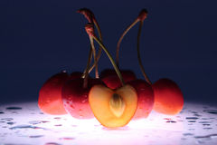 The cherries on dark blue Royalty Free Stock Image