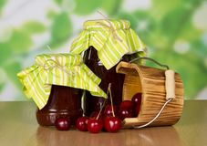 Cherries that dropped out of wooden bucket Royalty Free Stock Photography