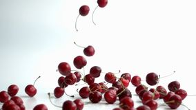cherries falling in slow motion
