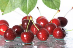 Cherries falling in water Stock Photography