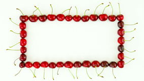 Cherries frame. On white background. Top view. stop motion animation, 4K stock video footage