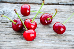 Cherries. Fresh organic red cherries with stems  on wooden background Stock Photo
