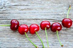 Cherries. Fresh organic red cherries with stems  on wooden background Stock Photography