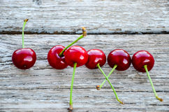 Cherries. Fresh organic red cherries with stems  on wooden background Stock Images