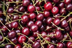 Cherries. Fresh red cherries background texture Stock Images