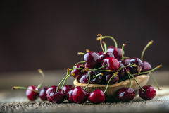 Cherries. Fresh sweet cherries. Delicious cherries with water drops in retro bowl on old oak table Royalty Free Stock Photography