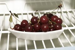 Cherries in fridge Royalty Free Stock Images