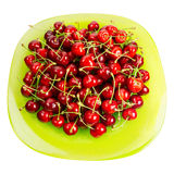 Cherries fruits  in a green glass bowl Royalty Free Stock Photography