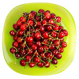 Cherries fruits  in a green glass bowl Royalty Free Stock Photos