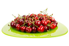 Cherries fruits  in a green glass bowl isolated Stock Image