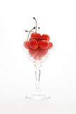 Cherries and glass Stock Image