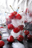 Cherries in glass. With ice stock image