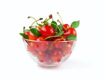Cherries in glass bowl. Isolated on white background Royalty Free Stock Photography