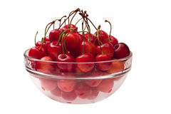 Cherries in a glass bowl. Side view. Isolated on a white background Royalty Free Stock Images