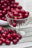 Cherries in a glass bowl on a table Royalty Free Stock Photos