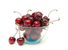 Cherries in a glass bowl on a white background Royalty Free Stock Photo