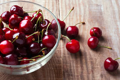 Cherries in a glass bowl Stock Image