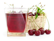 Cherries and a glass of cherry juice Royalty Free Stock Photos