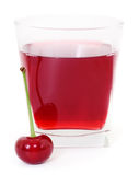 Cherries and a glass of cherry juice Royalty Free Stock Image