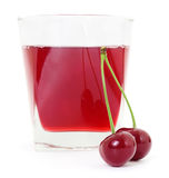 Cherries and a glass of cherry juice Stock Photography