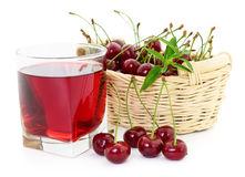 Cherries and a glass of cherry juice Stock Image
